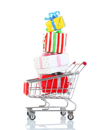christmas budget: Small shopping cart with present boxes isolated on white