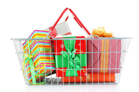 christmas budget: Metal basket full of present boxes isolated on white