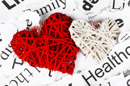 Decorative wicker hearts on background of paper notes photo