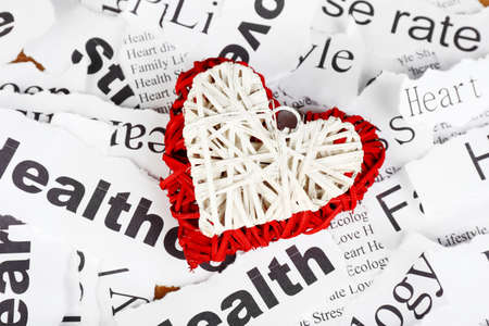 Decorative wicker  heart on background of paper notes photo