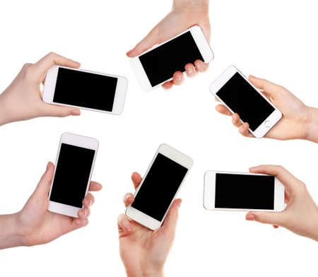 Hands holding smartphones isolated on white photo