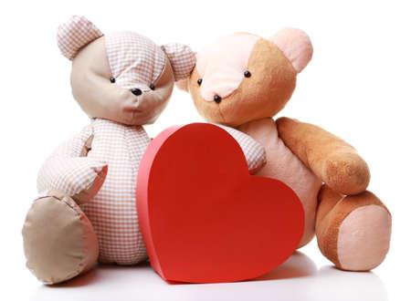 teddy bear love: Teddy Bears with red heart isolated on white