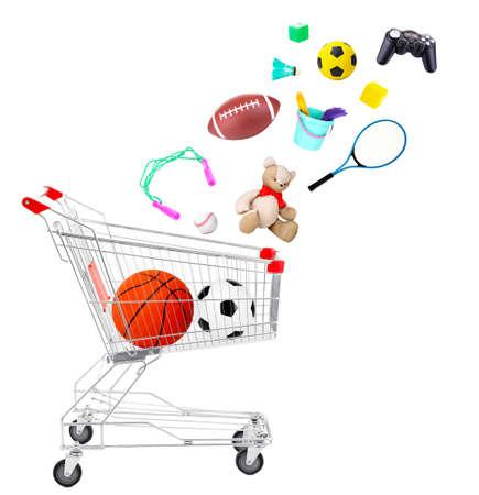strong base: Articoli sportivi e giocattoli che rientrano nel carrello isolato su bianco Archivio Fotografico