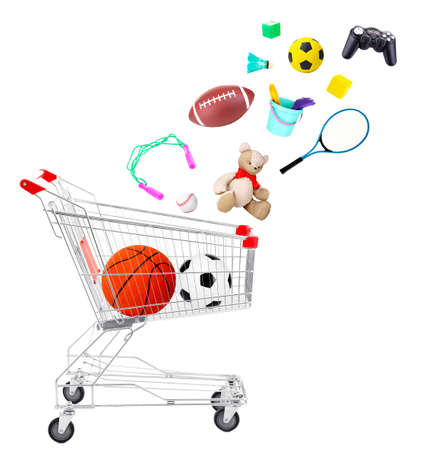 Sport goods and toys falling into cart isolated on white photo