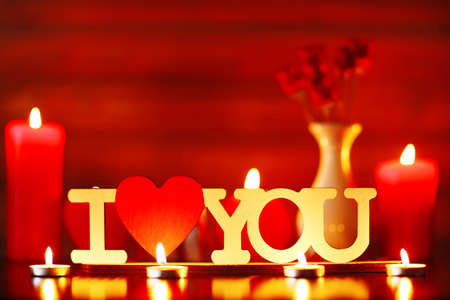 involving: Burning candles for Valentine Day, weddings,events involving love Archivio Fotografico