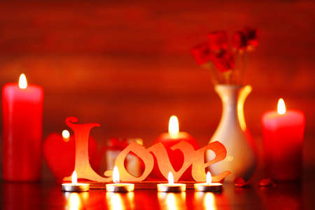 burning love: Burning candles for Valentine Day, weddings,events involving love Stock Photo
