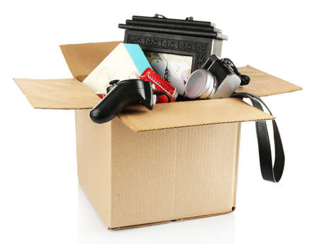 garage sale: Box of unwanted stuff isolated on white