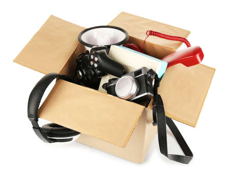 Box of unwanted stuff isolated on white photo