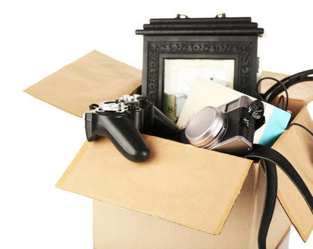 stuff: Box of unwanted stuff isolated on white