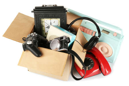 unnecessary: Box of unwanted stuff isolated on white