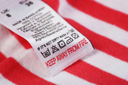 dry cleaned: Label with laundry care symbols close-up on clothing Stock Photo