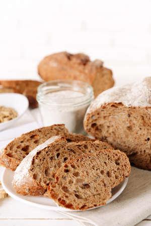 Tasty bread on table on light background photo