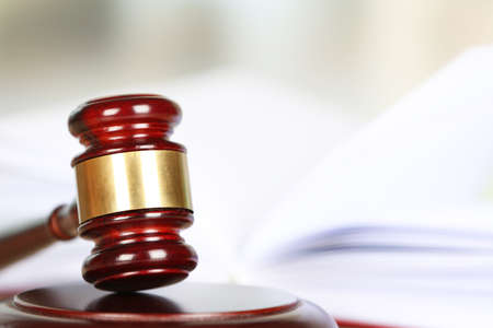 defendant: Wooden judges gavel, close up
