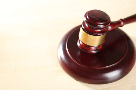 defendant: Wooden judges gavel on wooden table, close up Stock Photo