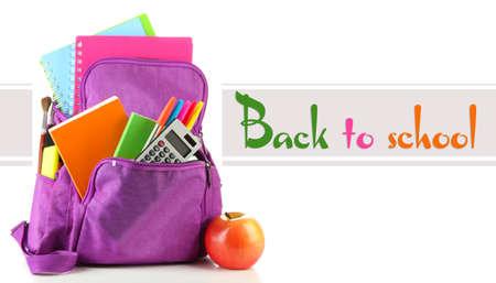 Lila Rucksack mit Schulmaterial auf weißem Standard-Bild - 37542458