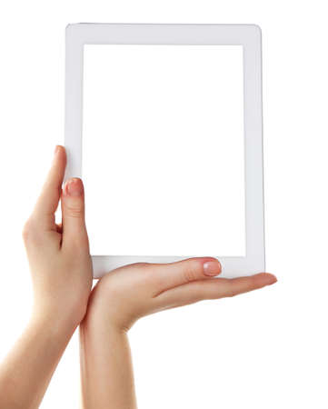 Hands holding tablet pc isolated on white photo