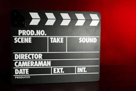 Movie clapper on dark color background photo