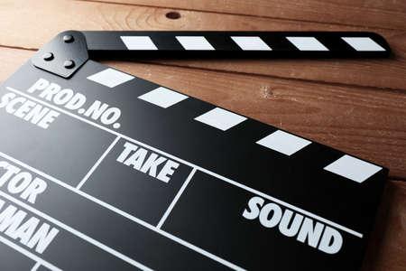 clapper: Movie clapper on wooden background