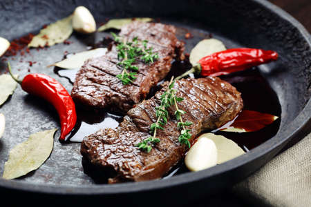 Steak in frying pan close up Stock Photo