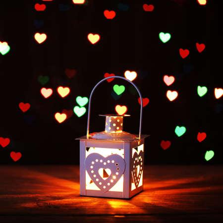 cosily: Lantern on colorful lights background Stock Photo