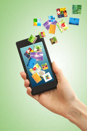 touch screen phone: Touch screen mobile phone with streaming images on green background