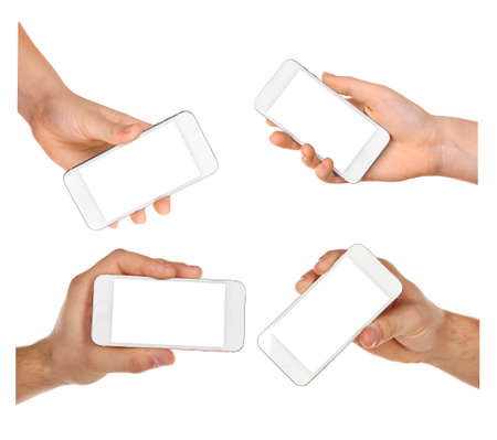 Hands holding smart phones isolated on white photo