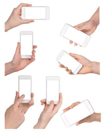 muchas personas: Manos que sostienen los tel�fonos inteligentes aislados en blanco