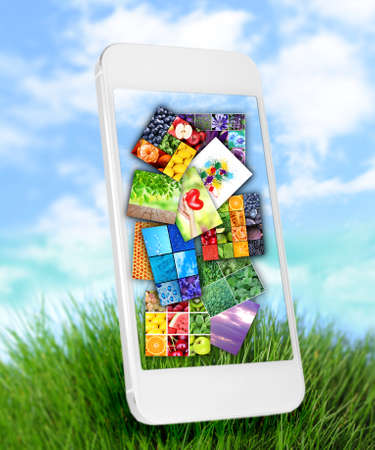 touch screen phone: Touch screen mobile phone with beautiful images on nature background