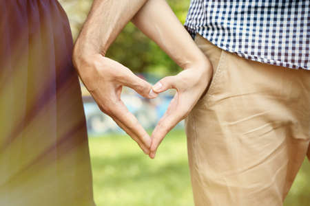 Loving couple holding hands outdoors Stock Photo