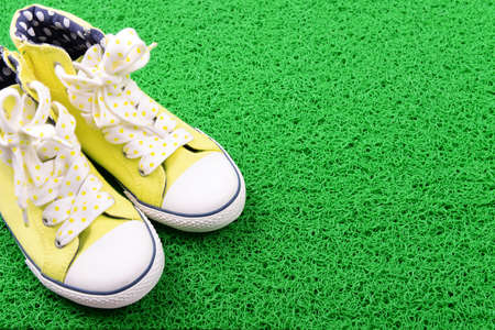 green carpet: Sneakers on green carpet background