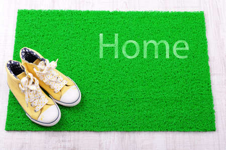 green carpet: Sneakers and green carpet on floor
