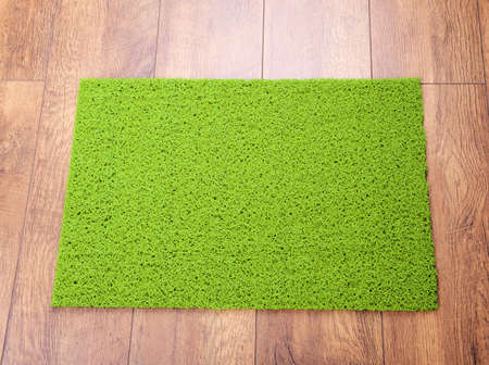 green carpet: Green carpet on floor close-up Stock Photo