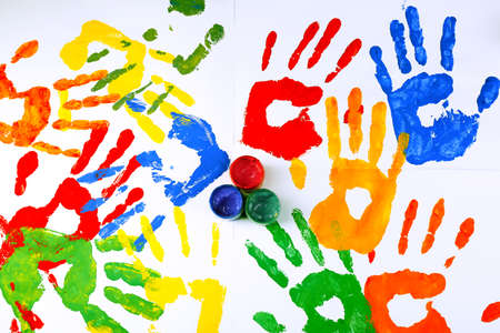 Hand prints of paint with paint on white background Stock Photo