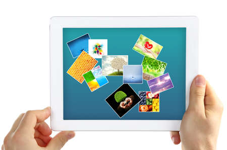 Hands holding tablet PC with different pictures on screen isolated on white photo