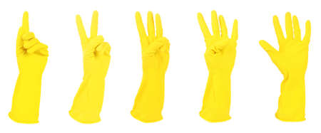 Yellow gloves gesturing numbers isolated on white photo