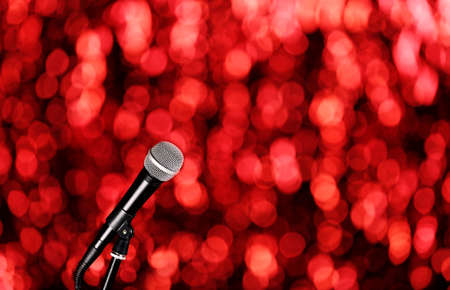 amplified: Microphone on bright red background