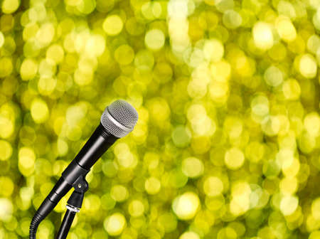 amplified: Microphone on bright yellow background