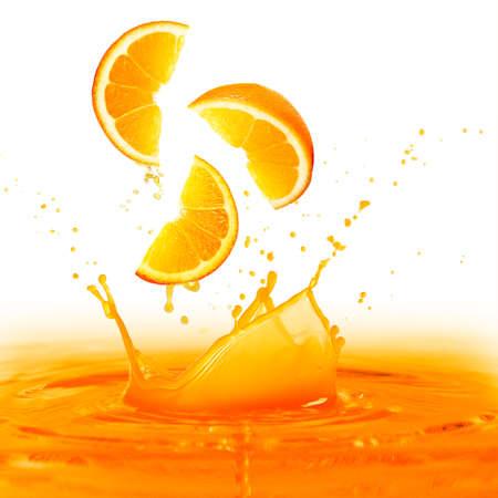 sliced orange: Splashing orange juice isolated on white