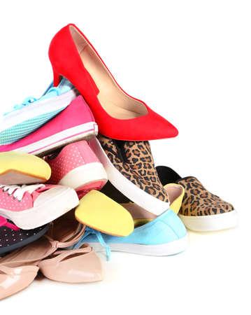 zapatillas ballet: Pila de varios zapatos femeninos aislados en blanco Foto de archivo