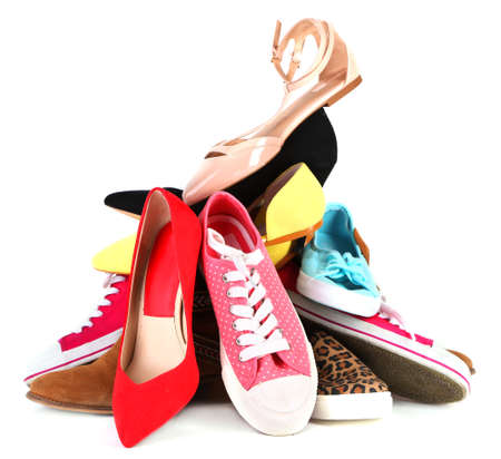 Pile of various female shoes isolated on white photo