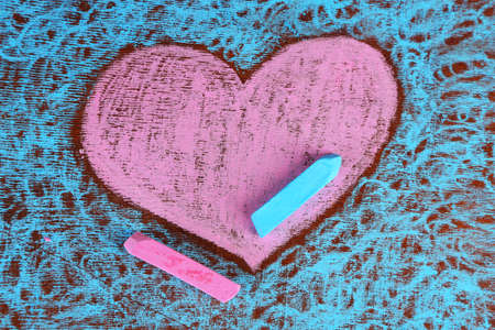 chalks: Heart drawn of chalks on wooden background close-up