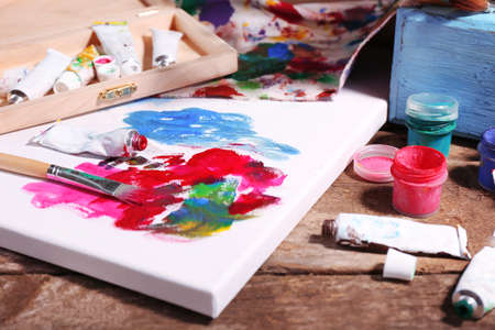 color color palette: Professional art materials on wooden background