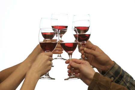 clinking: Clinking glasses of red wine in hands isolated on white