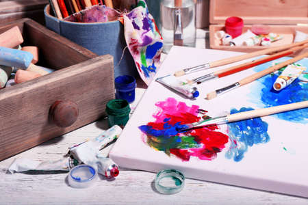 art materials: Professional art materials on color wooden background Stock Photo