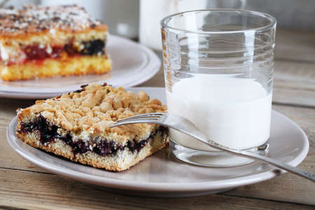 Homemade pies with jam and glass of milk photo