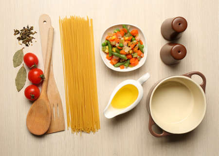 cooking utensils: Food ingredients and kitchen utensils for cooking on wooden background