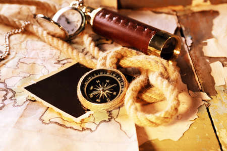 Marine still life spyglass and world map on old wooden background photo