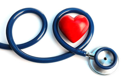 cardiac care: Stethoscope with heart on light background Stock Photo