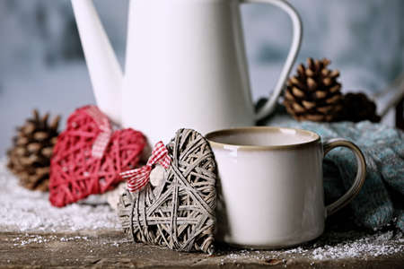 Winter composition with hot beverage on nature background photo