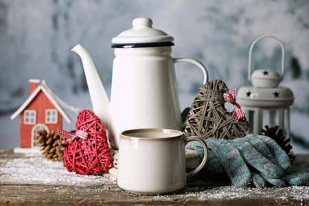 tea cosy: Winter composition with hot beverage on nature background Stock Photo